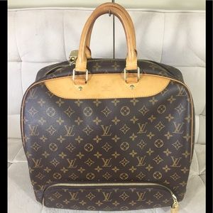 Authentic Louis Vuitton Evasion Travel bag